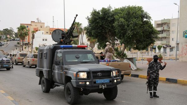 A member of security forces loyal to Libya's internationally recognised government is seen during a security deployment in Tarhouna city, Libya June 11, 2020 - Sputnik International