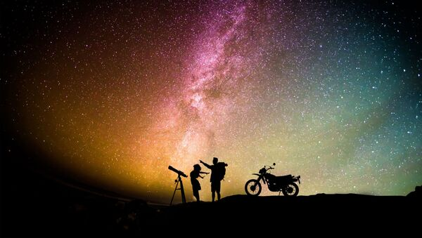 Woman standing between telescope with stand and motorcycle - Sputnik International