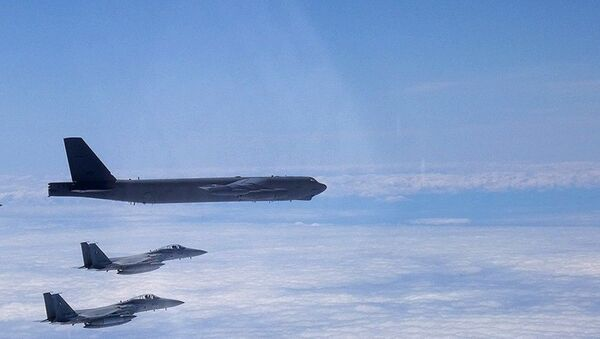 A B-52H Stratofortress deployed from Barksdale Air Force Base, La., flies alongside two Japan Air Self-Defense Force F-15s over the Sea of Japan while conducting a Bomber Task Force mission June 16, 2020. Bomber Task Force missions help maintain global stability and security while enabling units to become familiar with operations in different regions - Sputnik International