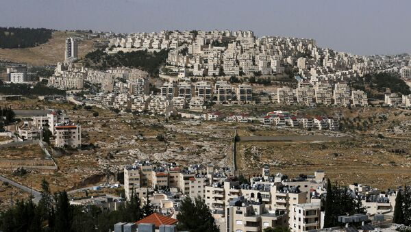 A view shows the Israeli settlement of Har Homa in the background as Palestinian houses are seen in the foreground, in the Israeli-occupied West Bank, May 19, 2020. Picture taken May 19, 2020.  - Sputnik International