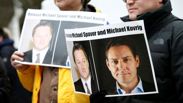 People hold signs calling for China to release Canadian detainees Michael Spavor and Michael Kovrig during an extradition hearing for Huawei Technologies Chief Financial Officer Meng Wanzhou at the B.C. Supreme Court in Vancouver, British Columbia, Canada - Sputnik International