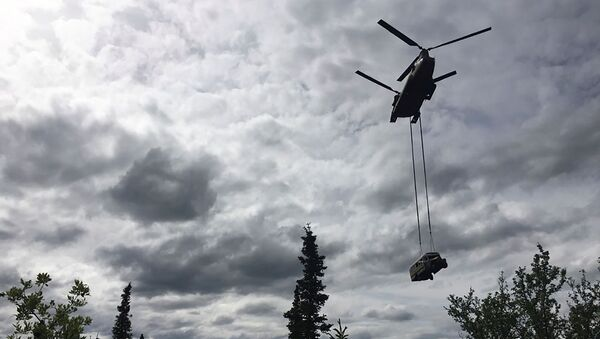 An Alaska Army National Guard CH-47 Chinook helicopter carries the bus made famous by the Into the Wild book and movie during its relocation near Stampede Trail west of Healy, Alaska, U.S. June 18, 2020. Alaska Department of Natural Resources/Handout via REUTERS.  THIS IMAGE HAS BEEN SUPPLIED BY A THIRD PARTY. - Sputnik International