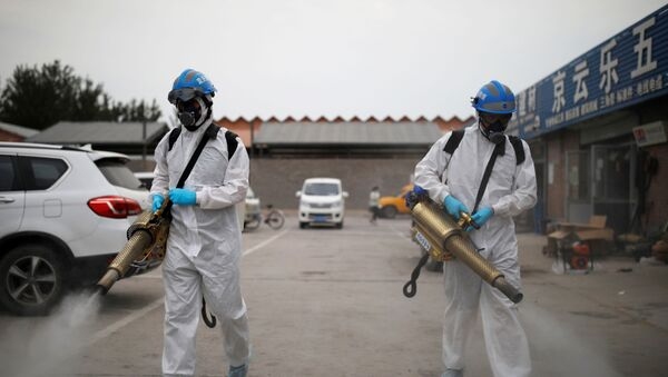 Volunteers from the Blue Sky Rescue team, in protective suits, disinfect the Nangong comprehensive market following a new outbreak of the coronavirus disease (COVID-19) in Beijing, China, June 18, 2020. Picture taken June 18, 2020. REUTERS/Carlos Garica Rawlins - Sputnik International