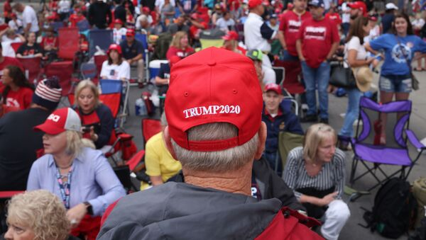 Supporters of U.S. President Donald Trump gather to attend a campaign rally at the BOK Center, June 20, 2020 in Tulsa, Oklahoma. President Trump is scheduled to hold his first political rally since the start of the coronavirus pandemic at the BOK Center on Saturday while infection rates in the state of Oklahoma continue to rise - Sputnik International