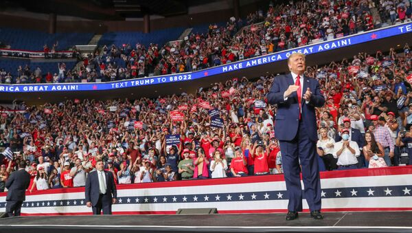 U.S. President Donald Trump reacts to the crowd as he arrives onstage at his first re-election campaign rally in several months in the midst of the coronavirus disease (COVID-19) outbreak, at the BOK Center in Tulsa, Oklahoma, U.S., June 20, 2020. - Sputnik International