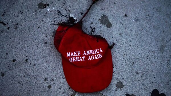 A burnt Make America Great Again (MAGA) hat lies on the ground during a protest against racial injustice near the site of a rally by U.S. President Donald Trump in Tulsa, Oklahoma, U.S., June 20, 2020. - Sputnik International