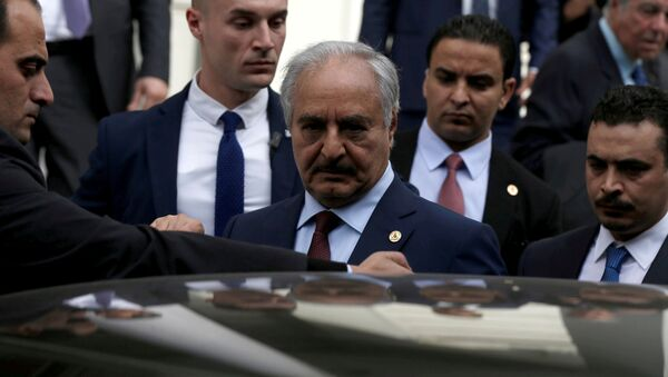 Libyan commander Khalifa Haftar gets into a car after a meeting with Greek Foreign Minister Nikos Dendias at the Foreign Ministry in Athens, Greece, January 17, 2020 - Sputnik International