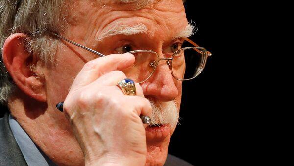 Former U.S. national security adviser John Bolton adjusts his glasses during his lecture at Duke University in Durham, North Carolina, U.S. February 17, 2020 - Sputnik International