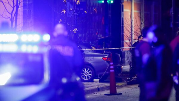 Police officers walk past a car which, according to local media, was crashed by a man into the exterior gate of the Chinese embassy in Buenos Aires, Argentina June 22, 2020. - Sputnik International