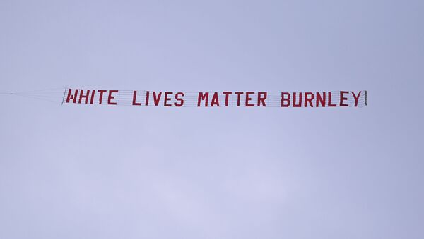 Soccer Football - Premier League - Manchester City v Burnley - Etihad Stadium, Manchester, Britain - June 22, 2020 A White Lives Matter Burnley banner is seen tied to a plane above the stadium, as play resumes behind closed doors following the outbreak of the coronavirus disease (COVID-19) - Sputnik International