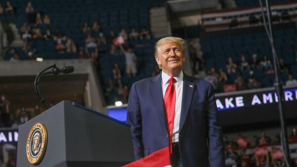 U.S. President Donald Trump smiles at the crowd as he arrives at the podium to speak during his first re-election campaign rally in several months in the midst of the coronavirus disease (COVID-19) outbreak, at the BOK Center in Tulsa, Oklahoma, U.S., June 20, 2020 - Sputnik International