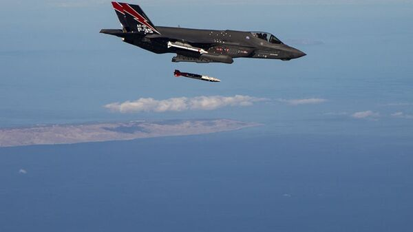 An F-35A releases ordnance during a dual capable aircraft (DCA) test flight in the skies above Edwards Air Force Base, California, on February 6, 2020. - Sputnik International