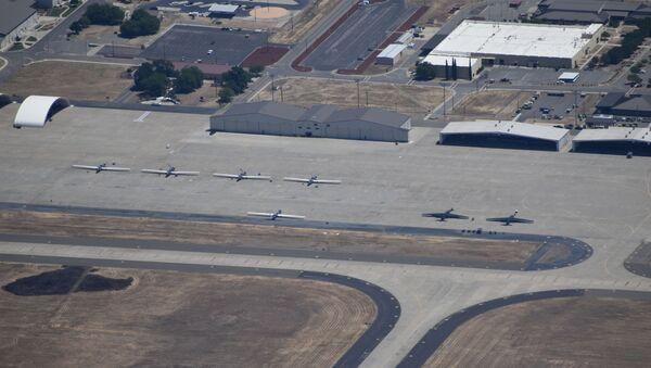 RQ-4 Global Hawk drones and U-2 Dragon Lady spy planes sit on the tarmac at Beale Air Force Base, California - Sputnik International