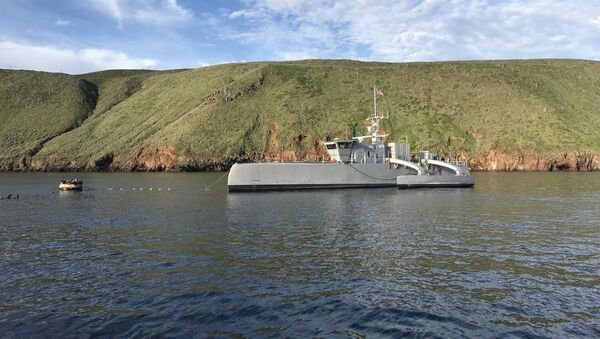 181031-N-YG220-003 (Feb. 1, 2019) Sea Hunter, an entirely new class of unmanned sea surface vehicle developed in partnership between the Office of Naval Research (ONR) and the Defense Advanced Research Projects Agency (DARPA), recently completed an autonomous sail from San Diego to Hawaii and back—the first ship ever to do so autonomously. Sea Hunter is part of ONR's Medium Displacement Unmanned Surface Vehicle (MDUSV) project - Sputnik International