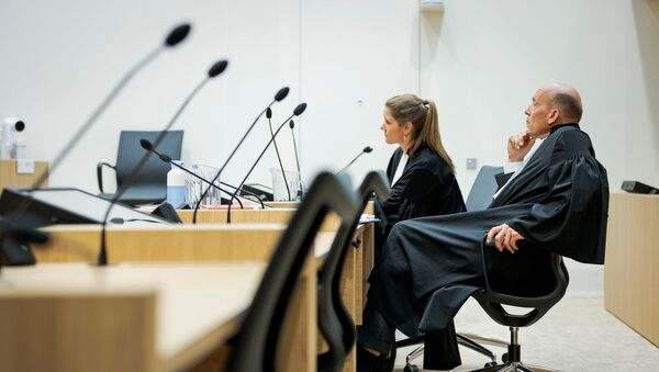 Sabine ten Doesschate and Boudewijn van Eijck, lawyers of defendant Oleg Pulatov are seen in a courtroom of The Schiphol Judicial Complex, prior to the criminal trial against four suspects in the July 2014 downing of Malaysia Airlines flight MH17, in Badhoevedorp, Netherlands, June 8, 2020.  - Sputnik International