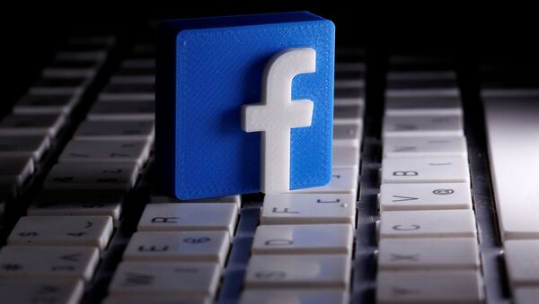 A 3D-printed Facebook logo is seen placed on a keyboard in this illustration taken March 25, 2020 - Sputnik International