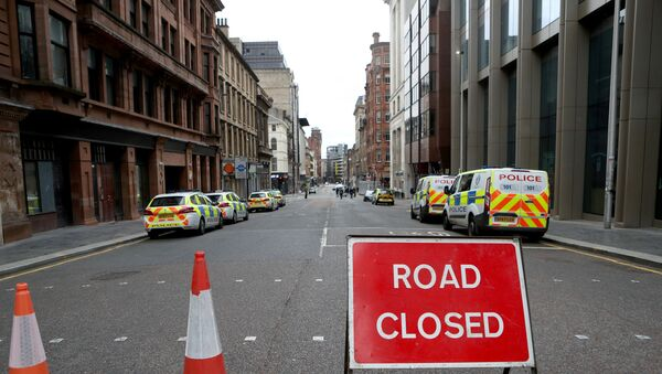 Police vehicles are seen parked near the scene of reported multiple stabbings at West George Street in Glasgow, Scotland, Britain June 27, 2020. - Sputnik International