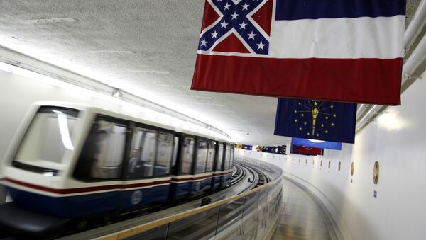 The Mississippi state flag, which incorporates the Confederate battle flag, hangs with other state flags in the subway system under the U.S. Capitol in Washington June 23, 2015. - Sputnik International