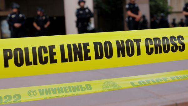 Law enforcement officers are seen behind police tape during a demonstration against the death in Minneapolis police custody of George Floyd, in Anaheim, California, U.S., June 1, 2020. - Sputnik International