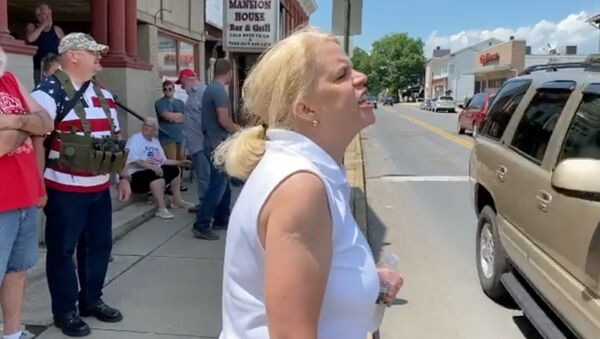 Video recording captures an unidentified woman at a alongside a group of counter-protesters firing off a profanity-laced rant against a group of Black Lives Matter protesters in Watsontown, Pennsylvania. - Sputnik International