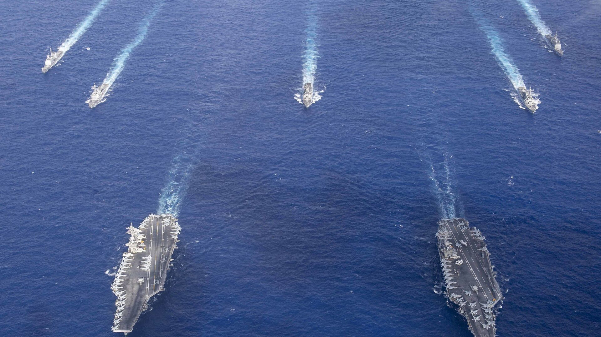 The Theodore Roosevelt Carrier Strike Group transits in formation with the Nimitz Carrier Strike Group while conducting dual carrier and airwing operations in the Philippine Sea June 23, 2020. - Sputnik International, 1920, 17.09.2021