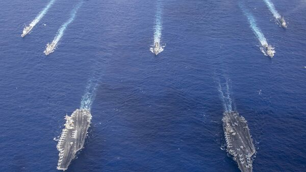 The Theodore Roosevelt Carrier Strike Group transits in formation with the Nimitz Carrier Strike Group while conducting dual carrier and airwing operations in the Philippine Sea June 23, 2020. - Sputnik International
