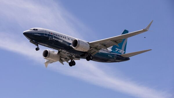 A Boeing 737 MAX airplane lands after a test flight at Boeing Field in Seattle, Washington, U.S. June 29, 2020 - Sputnik International