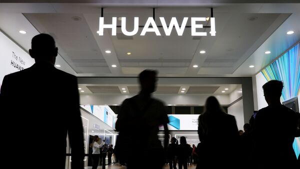 The Huawei logo is pictured at the IFA consumer tech fair in Berlin - Sputnik International