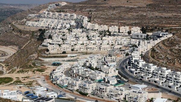 A view shows Israeli settlement buildings around Givat Zeev and Ramat Givat Zeev in the Israeli-occupied West Bank, near Jerusalem June 30, 2020 - Sputnik International