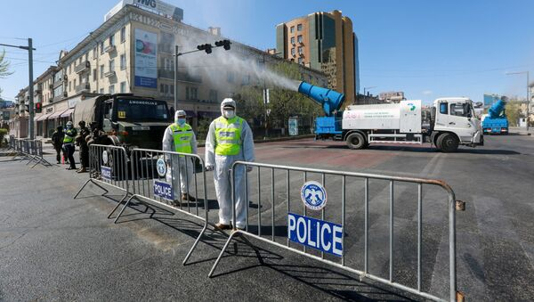 Staff members and police officers wear hazmat suits as they take part in a drill to prepare for the COVID-19 coronavirus in Ulaanbaatar, the capital of Mongolia on May 7, 2020 - Sputnik International