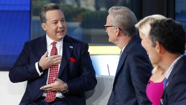 Fox News Chief National Correspondent Ed Henry, left, appears with co-hosts Steve Doocy, second left, Ainsley Earhardt, and Brian Kilmeade on the Fox & friends television program, in New York on Sept. 6, 2019. Fox News has fired news anchor Henry after it received a complaint about workplace sexual misconduct by him - Sputnik International