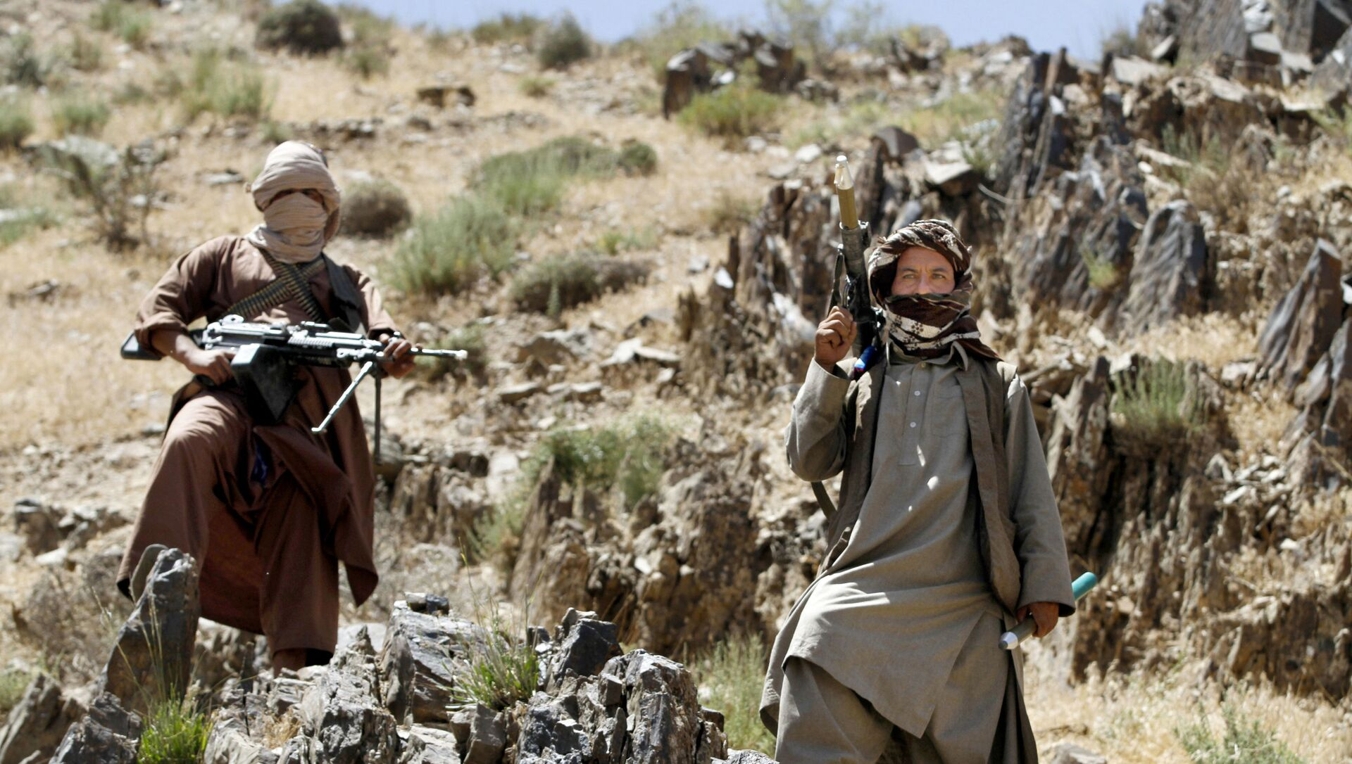 In this Friday, May 27, 2016 photo, Taliban fighters stand guard as senior leader of a breakaway faction of the Taliban Mullah Abdul Manan Niazi, not pictured, delivers a speech to his fighters, in Shindand district of Herat province, Afghanistan - Sputnik International, 1920, 23.07.2021