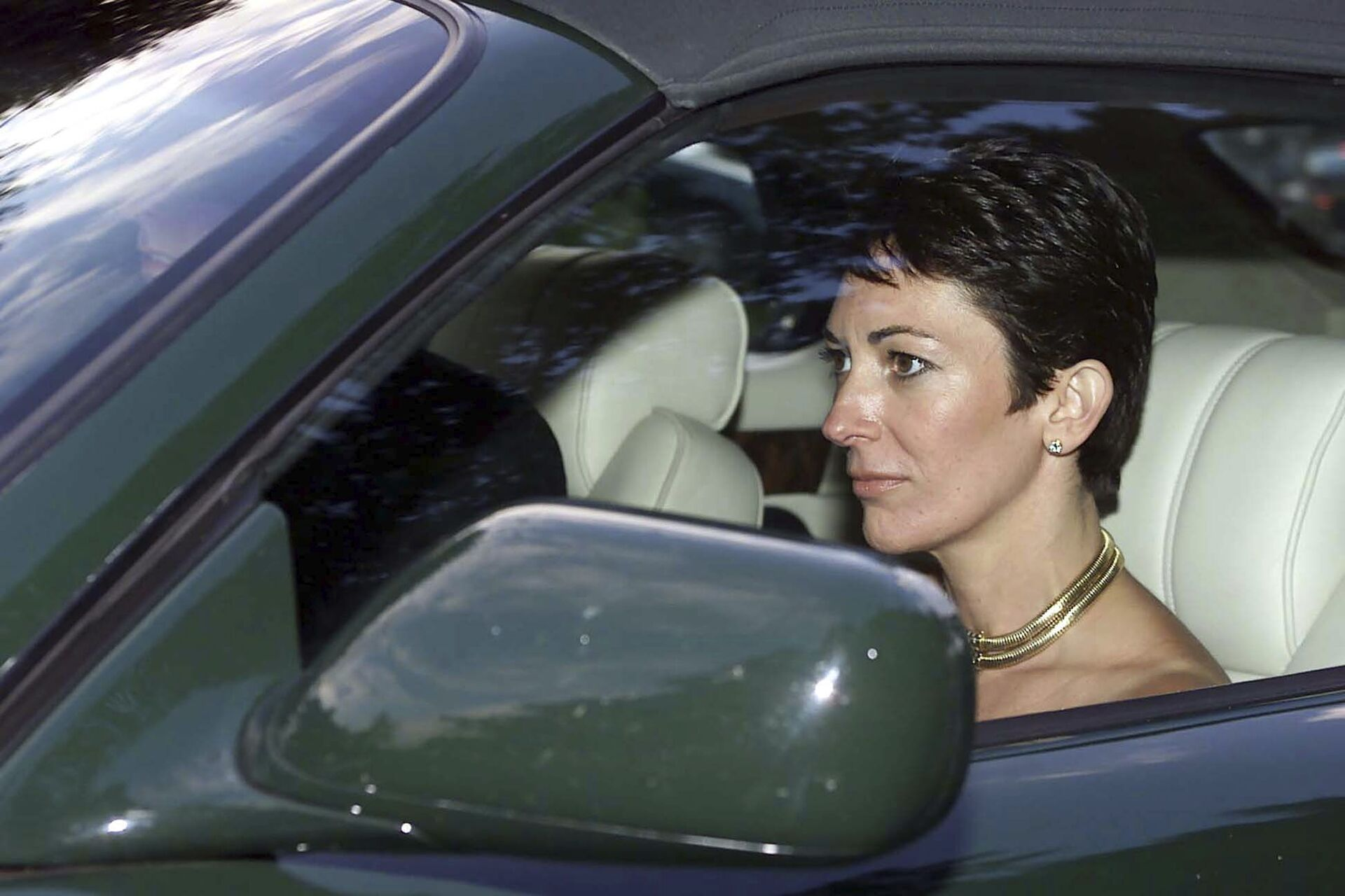 FILE - In this Sept. 2, 2000 file photo, British socialite Ghislaine Maxwell, driven by Britain's Prince Andrew leaves the wedding of a former girlfriend of the prince, Aurelia Cecil, at the Parish Church of St Michael in Compton Chamberlayne near Salisbury, England. The FBI said Thursday July 2, 2020, Ghislaine Maxwell, who was accused by many women of helping procure underage sex partners for Jeffrey Epstein, has been arrested in New Hampshire. - Sputnik International, 1920, 07.09.2021