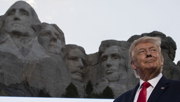 President Donald Trump smiles at Mount Rushmore National Memorial, Friday, July 3, 2020, near Keystone, S.D. (AP Photo/Alex Brandon) - Sputnik International
