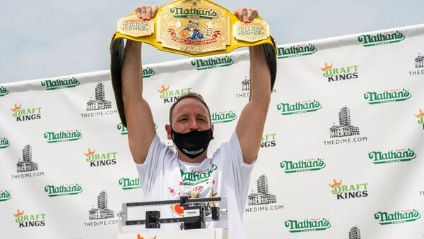 Current world record holder Joey Chestnut carries his belt as he poses during the official weigh-in ceremony for the Nathan's Famous Fourth of July International Hot Dog Eating Contest, in New York, U.S., July 3, 2020. - Sputnik International