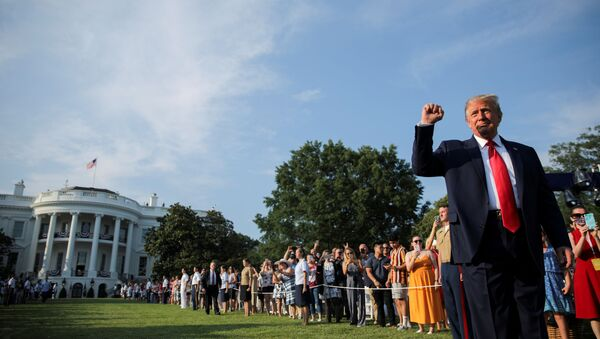 U.S. President Donald Trump thrusts his fist as he arrives on the White House South Lawn to host a 4th of July 2020 Salute to America to celebrate the U.S. Independence Day holiday at the White House in Washington, U.S., July 4, 2020 - Sputnik International