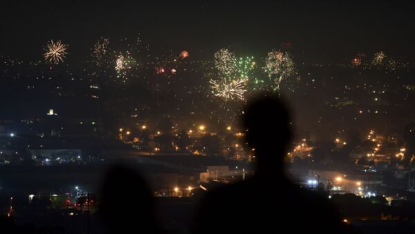 People watch fireworks burst over Los Angeles, California on July 4, 2020 during celebrations for the Fourth of July holiday, amid the coronavirus pandemic. - Sputnik International