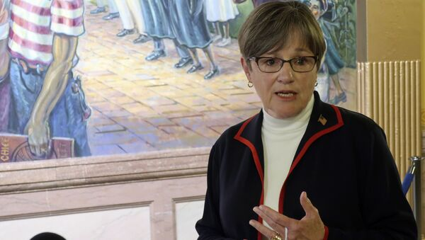 Kansas Gov. Laura Kelly answers questions from reporters about the coronavirus pandemic after a meeting with legislative leaders, Thursday, July 2, 2020, at the Statehouse in Topeka, Kan. - Sputnik International