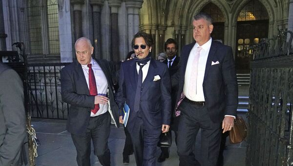 Actor Johnny Depp, centre, leaves the High Court in London, after attending a preliminary hearing in his libel case against the publishers of The Sun and its executive editor, Dan Wootton, over a 2018 article alleging he had been abusive to his ex-wife Amber Heard, 26 February 2020. - Sputnik International