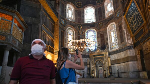 A woman takes a picture with mobile phone inside the Hagia Sophia museum in Istanbul, on July 2, 2020. - Turkey's top court considered whether Istanbul's emblematic landmark and former cathedral Hagia Sophia can be redesignated as a mosque, a ruling which could inflame tensions with the West. - Sputnik International
