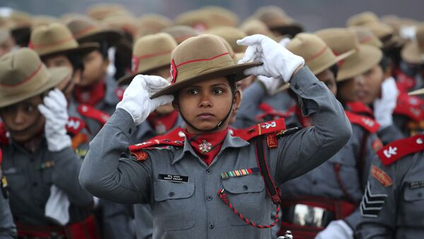 Indian Para-military women soldiers of Assam Rifles adjust their hats during the rehearsals for the upcoming Republic Day parade on Rajpath, the ceremonial boulevard, in New Delhi, India, Monday, Jan. 14, 2019 - Sputnik International