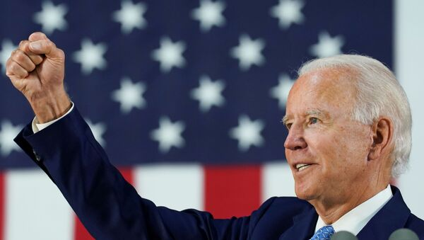 Democratic U.S. presidential candidate and former Vice President Joe Biden thrusts his fist while answering questions from reporters during a campaign event in Wilmington, Delaware, U.S., June 30, 2020. - Sputnik International