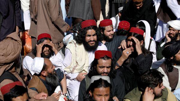 Newly freed Taliban prisoners sit at Pul-i-Charkhi prison, in Kabul - Sputnik International