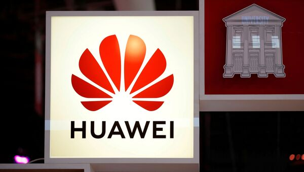 FILE PHOTO: The Huawei logo is seen at the high profile startups and high tech leaders gathering, Viva Tech,in Paris, France May 16, 2019 - Sputnik International