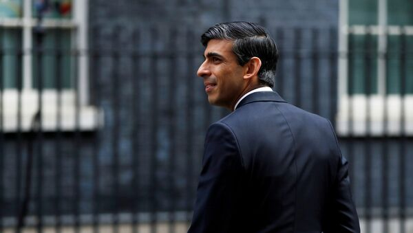 Chancellor of the Exchequer Rishi Sunak is seen as he arrives at Downing Street - Sputnik International