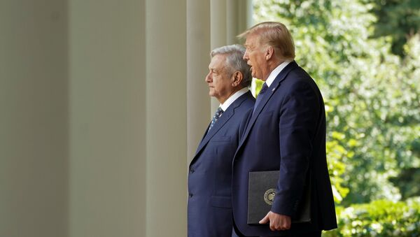 U.S. President Donald Trump leads Mexico's President Andres Manuel Lopez Obrador down the West Wing colonnade to a signing ceremony in the Rose Garden at the White House in Washington, U.S., July 8, 2020. - Sputnik International