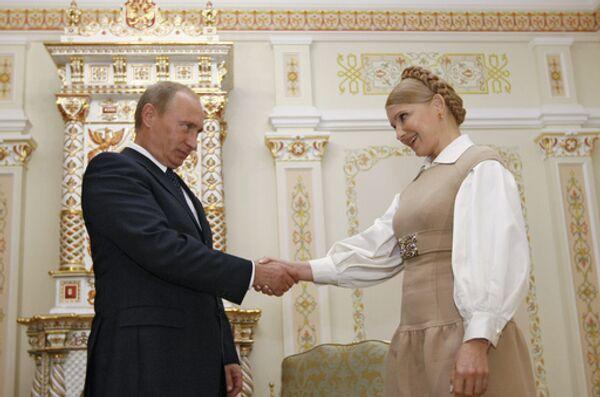 Встреча глав правительств России и Украины Владимира Путина и Юлии Тимошенко - Sputnik International