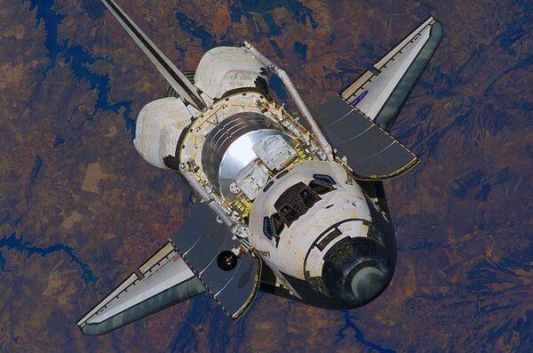 NASA postpones shuttle Discovery landing due to bad weather - Sputnik International