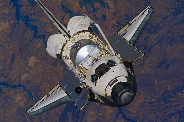 Shuttle Discovery to stay in orbit for another day - NASA - Sputnik International