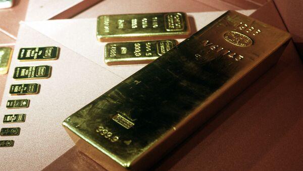 Золотые слитки 999,9 пробы из фондов Гохрана - Sputnik International